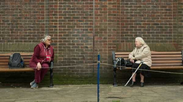 Two old ladies social distancing